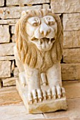 MARBLE LION STATUE IN GINA PRICES CORFU GARDEN.