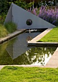 RICHARD JACKSONS GARDEN. DESIGNED BY CLARE MATTHEWS - WATER FEATURE - RECTANGULAR POOL/ POND WITH METAL SAIL AND FOUNTAIN