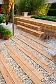 HAMPTON COURT FLOWER SHOW 2006: DESIGNER - PHILIP OSMAN - GRAVEL GARDEN WITH WOODEN SLEEPER PATH WITH STEPS AND THYME RUG