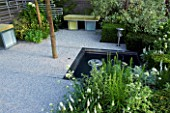 HAMPTON COURT FLOWER SHOW 2006: DESIGNER - ALISON SLOGA - SILVER  WHITE AND GREEN MODERN FORMAL CONTEMPORARY GARDEN. SEATS WITH GREEN CUSHIONS  GRAVEL  SAMLL FORMAL POND  POOL