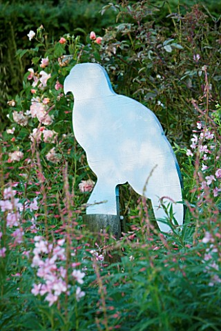 VEDDW_HOUSE_GARDEN__GWENT__WALES_DESIGNERS_ANNE_WAREHAM_AND_CHARLES_HAWES__WOODEN_CUT_OUT_BUZZARD_SC