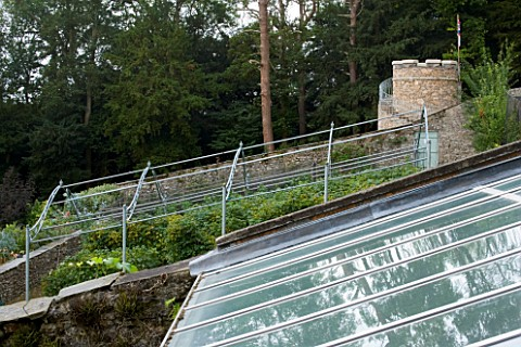 YEWBARROW_HOUSE_GARDENS__CUMBRIA__THE_WALLED_VEGETABLE_GARDEN_WITH_THE_NEW_ROUND_TOWER_IN_THE_BACKGR