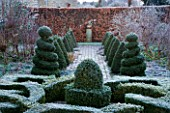 WOODPECKERS  WARWICKSHIRE  WINTER: THE FORMAL TOPIARY GARDEN IN FROST WITH KNOT GARDEN AND BOX TOPIARY TWIRLS  STATUE AND BEECH HEDGE