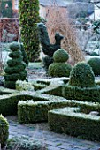 WOODPECKERS  WARWICKSHIRE  WINTER: THE FORMAL TOPIARY GARDEN IN FROST WITH KNOT GARDEN AND BOX TOPIARY TWIRLS AND CHICKEN
