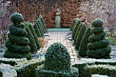 WOODPECKERS  WARWICKSHIRE  WINTER: FORMAL GARDEN IN FROST WITH KNOT GARDEN  TWISTED TOPIARY SHAPES   BRICK PATH  STATUE AND BEECH HEDGE