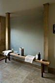 BOONSHILL FARM  EAST SUSSEX. INTERIOR OF BATHROOM WITH WOODEN BENCH WITH MOTHER OF PEARL INLAY FROM INDIA. DESIGNER: LISETTE PLEASANCE