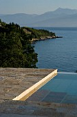 CORFU  GREECE: VILLA ZOGRAFIA  NORTH EAST CORFU. DESIGN BY ALITHEA JOHNS OF SKOPOS DESIGN AND RAHDY ELWAN. SWIMMING POOL WITH VIEWS OVER SOUKIA BAY. EARLY MORNING