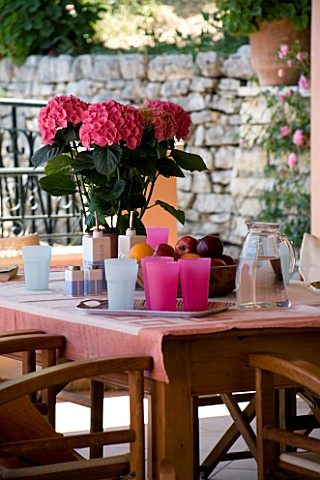 VILLA_CHRISTINA___KAMINAKI__CORFU__GREECE_COVERED_OUTDOOR_PATIO_TERRACE_DINING_AREA_WITH_WOODEN_TABL
