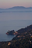 CORFU  GREECE: VIEW OF AGNI WITH CORFU TOWN IN THE FAR DISTANCE