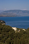 CORFU  GREECE: VIEW OF YIALISKARI HOUSE WITH ALBANIAN MOUNTAINS BEYOND