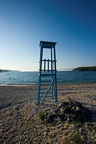 CORFU__GREECE_VIEW_OF_AVLAKI_BEACH_WITH_LIFE_GUARD_WATCH_TOWER