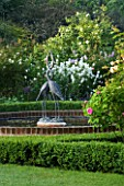 MARINERS GARDEN  BERKSHIRE. DESIGNER FENJA ANDERSON - THE ROSE GARDEN - THE WATER LILY POOL WITH HERON SCULPTURE.