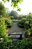 MARINERS GARDEN  BERKSHIRE. DESIGNER FENJA ANDERSON - VIEW INTO THE ROSE GARDEN TO THE WATER LILY POOL WITH HERON SCULPTURE