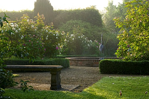 MARINERS_GARDEN__BERKSHIRE_DESIGNER_FENJA_ANDERSON__VIEW_INTO_THE_ROSE_GARDEN_AT_DAWN_TO_THE_WATER_L