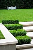 CONTEMPORARY TOWN/CITY/URBAN GARDEN DESIGNED BY CHARLOTTE SANDERSON: LAWN WITH METAL SEAT AND LIMESTONE STEPS WITH BOX RECTANGLES
