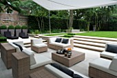CONTEMPORARY TOWN/URBAN/CITY GARDEN DESIGNED BY CHARLOTTE SANDERSON: ENTERTAINING/RELAXING AREA WITH AWNING  TABLE  CHAIRS  SOFAS AND STEPS LEADING TO LAWN