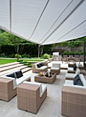 CONTEMPORARY TOWN/CITY/URBAN GARDEN DESIGNED BY CHARLOTTE SANDERSON: ENTERTAINING/RELAXING AREA WITH AWNING  TABLE  CHAIRS  SOFAS AND BARBEQUE AREA TO THE RIGHT