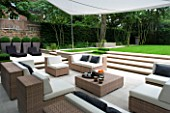CONTEMPORARY TOWN/CITY/URBAN GARDEN DESIGNED BY CHARLOTTE SANDERSON: ENTERTAINING/RELAXING AREA WITH AWNING OVER TABLE  CHAIRS AND SOFAS WITH STEPS LEADING TO LAWN