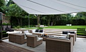 CONTEMPORARY TOWN/CITY/URBAN GARDEN DESIGNED BY CHARLOTTE SANDERSON: AWNING OVER ENTERTAINING/RELAXING/DINING AREA WITH STEPS LEADING TO LAWN