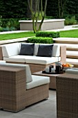CONTEMPORARY TOWN/CITY/URBAN GARDEN DESIGNED BY CHARLOTTE SANDERSON: OUTDOOR FURNITURE - TABLE AND SOFAS WITH CUSHIONS FOR RELAXING