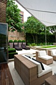 CONTEMPORARY TOWN/CITY/URBAN GARDEN DESIGNED BY CHARLOTTE SANDERSON: ENTERTAINING/RELAXING/DINING AREA WITH AWNING AND SOFA/CHAIRS