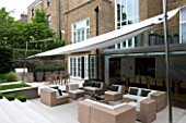 CONTEMPORARY TOWN/CITY/URBAN GARDEN DESIGNED BY CHARLOTTE SANDERSON: AWNING OVER ENTERTAINING/RELAXING/DINING AREA WITH TABLE  CHAIRS AND SOFAS
