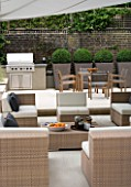 CONTEMPORARY TOWN/CITY/URBAN GARDEN DESIGNED BY CHARLOTTE SANDERSON: ENTERTAINING/RELAXING/DINING AREA WITH AWNING  BARBEQUE  TABLE  CHAIRS AND SOFAS  METAL PLANTERS WITH BOX