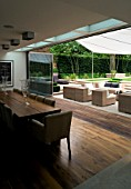 CONTEMPORARY TOWN/CITY/URBAN GARDEN DESIGNED BY CHARLOTTE SANDERSON: VIEW FROM INSIDE DINING AREA TO OUTSIDE ENTERTAINING AREA WITH AWNING OVER TABLE  CHAIRS AND SOFAS