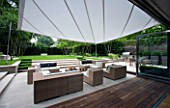 CONTEMPORARY TOWN/CITY/URBAN GARDEN DESIGNED BY CHARLOTTE SANDERSON: VIEW OUT TO AWNING OVER ENTERTAINING/RELAXING/DINING AREA WITH TABLE  CHAIRS AND SOFAS