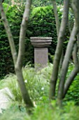 URBAN CONTEMPORARY MODERN MINIMALIST GARDEN DESIGNED BY CHARLOTTE SANDERSON: VIEW THROUGH TREES TO FOCAL POINT OF URN AT THE END OF A PATH