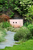 GARDEN DESIGNED BY CHARLOTTE SANDERSON: GREY SLATE PATH LEADS TO PINK RENDERED CEMENT WATER FEATURE