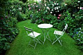 AMELIA HEATH GARDEN  1  CROSS VILLAS  SHROPSHIRE: THE SECRET GARDEN WITH LAWN  WOODEN TABLE AND CHAIRS
