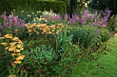 PETTIFERS  OXFORDSHIRE: BORDER WITH ACHILLEA TERRACOTTA  SANGUISORBA  THALICTRUM LUCIDUM  VERONICASTRUM APOLLO