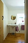 DESIGNER CLARE MATTHEWS: DEVON  THE BATHROOM WITH SINK  PURPLE TOWELS AND MIRROR