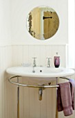 DESIGNER CLARE MATTHEWS: DEVON  THE BATHROOM WITH SINK  MIRROR AND PURPLE TOWELLS