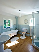DESIGNER CLARE MATTHEWS: DEVON  BLUE AND WHITE THEMED BATHROOM WITH SHOWER AND ROLL TOP BATH