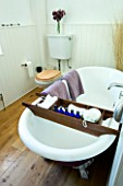 DESIGNER CLARE MATTHEWS: DEVON  BATHROOM WITH ROLL TOP BATH AND PURPLE TOWELLS