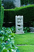 THROUGHAM COURT  GLOUCESTERSHIRE. DESIGNER: CHRISTINE FACER: LEXICON BATH STONE SCULPTURE BY TOM SHUTTERS IN THE LIBRARY GARDEN