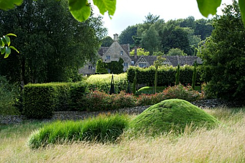 THROUGHAM_COURT__GLOUCESTERSHIRE_DESIGNER_CHRISTINE_FACER_THE_COURT_SEEN_FROM_THE_WALNUT_QUINCUNX_WI