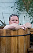 DARREN CLEMENTS GARDEN  STAFFORDSHIRE: DARREN IN HIS HOT TUB