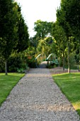 WILKINS PLECK  STAFFORDSHIRE: A GRAVEL PATH ALONG A LAWN TO A BLUE GIVERNY TYPE BRIDGE