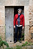 SUITE.DO OWNER RAFAEL DANES LEANING ON A DOOR IN MALLORCA  SPAIN