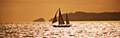 SUITE.DO. SHIP SAILING PAST CABRERA ISLAND AT SUNSET. MALLORCA  SPAIN