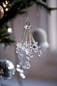 BOONSHILL FARM AT CHRISTMAS: LIVING ROOM - ORNATE GLASS CHRISTMAS TREE DECORATION. DESIGNER: LISETTE PLEASANCE