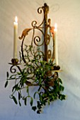 BOONSHILL FARM AT CHRISTMAS: THE DINING ROOM - ORNATE WALL MOUNTED CANDLE HOLDER WITH MISTLETOE. DESIGNER: LISETTE PLEASANCE