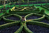 CERNEY HOUSE  GLOUCESTERSHIRE: FORMAL PARTERRE IN THE WALLED GARDEN WITH RHUBARB FORCING JARS