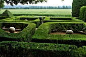 PROVENCE  FRANCE - ALTAVES. BOX TOPIARY GARDEN WITH SPHERICAL ORNAMENTAL STONE SCULPTURE