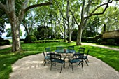 PROVENCE  FRANCE - ALTAVES. SEATING AREA IN FRONT OF HOUSE WITH LAWNED AREA AND HUGE PLANE TREES