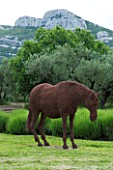 PRIVATE GARDEN  PROVENCE  FRANCE - DESIGNER DOMINIQUE LAFOURCADE. HORSE SCULPTURE BY RUPERT TILL