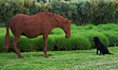PRIVATE GARDEN  PROVENCE  FRANCE - DESIGNER DOMINIQUE LAFOURCADE.HORSE AND DOG SCULPTURE BY RUPERT TILL